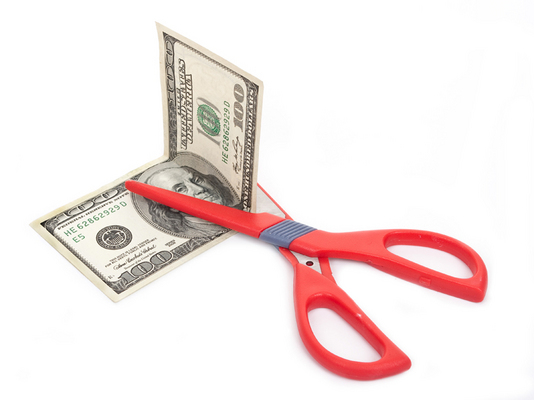 Scissors  to cut  a dollar